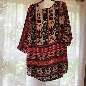 Cute pattern dress with criss cross back